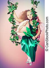 forest princess - Beautiful little fairy swinging on a swing...