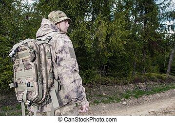 Forest Ranger at Work. Caucasian Forest Ranger Wearing...