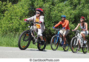 Forest ride - Portrait of happy boy riding bicycle in the ...