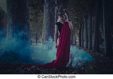 forest romantic scene, beautiful blond, fallen angel with black