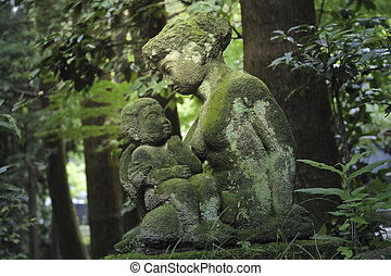 forest sculptures - stone sculptures of mother and child...