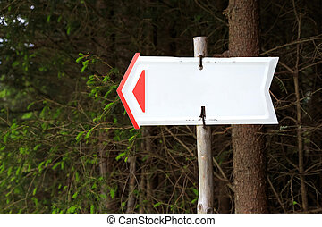 Forest sign in the form of an arrow