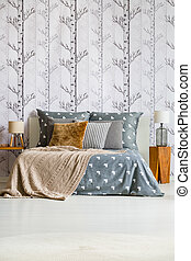 Forest wallpaper in bright bedroom