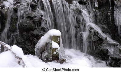 Forest waterfall in winter