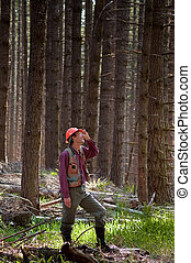 Forester in a Pacific Northwest forest - Forester standing...