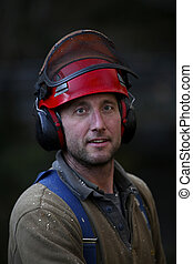 forestry worker - portrait of a forestry worker with helmet