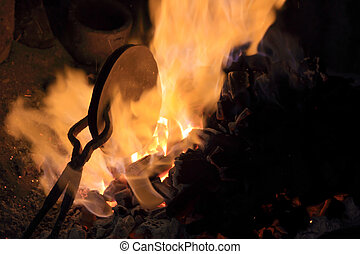 forge fire in blacksmith's where iron tools are crafted