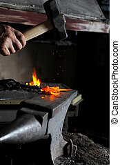 forge - Making a decorative element in the smithy on the...