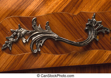 Forged handle on antique furniture