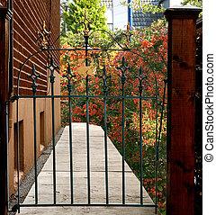 forged iron gate leading to a beautiful backyard - forged ...