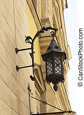 Forged lantern on the wall