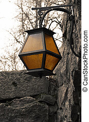 Forged lantern with yellow glasses