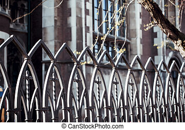 forged metal fence near the church