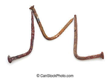 forged nails letters - old rusty bent nails in shape of...