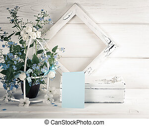 Forget-me-not flowers with birdcage and photo frame with casket in Shabby Chic style and greeting card. For this photo applied toning in retro style.