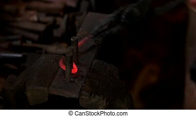 Forging hook tool at forge. Red hot metal on an anvil. ...