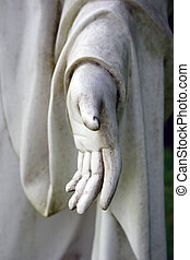 Forgive - Detail friom a stone hand with dark background