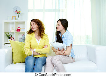 Forgive me - Photo of offended woman sitting on sofa with ...