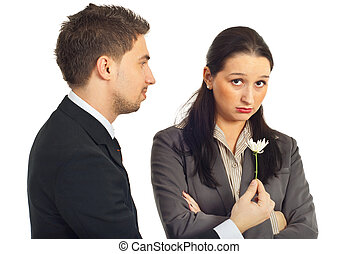 Forgive me! - Business man offering a little flower to his...