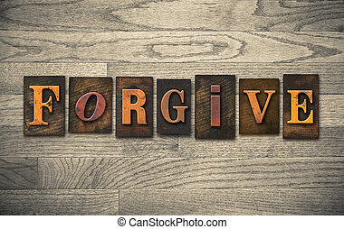 "The word ""FORGIVE"" written in vintage wooden letterpress type."