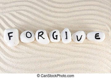 Forgive word on group of stones on the sand