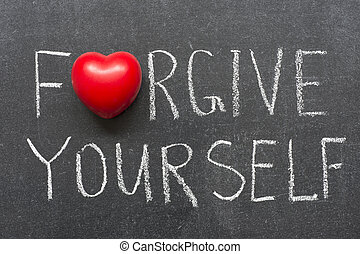 forgive yourself phrase handwritten on blackboard
