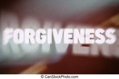Forgiveness word on vintage blurred background