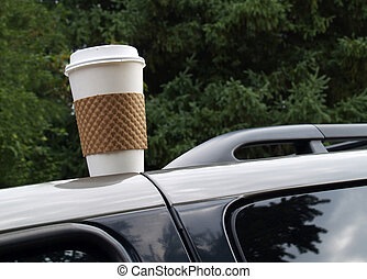 forgotten coffee cup - disposable coffee cup left on top of ...