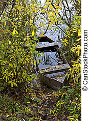 Forgotten fishing boat at a lake coast