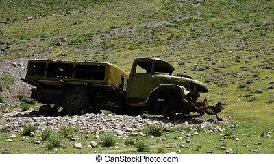 Forgotten war vehicle - A steady, medium shot of a...