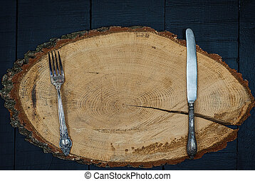 Fork and knife on a wooden frame, the empty space in the middle