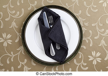 fork and knife with black table napkin