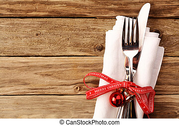 Fork and Knife with Christmas Decoration on Table