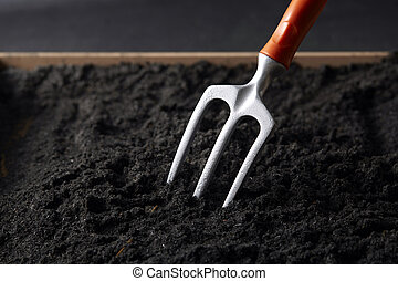 Fork digging on soil,close up