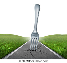 Fork in the road highway with a kitchen silverware metal...