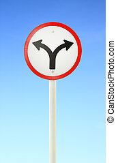 fork junction traffic sign with blue sky