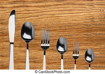 fork ,knife and spoon on wooden background