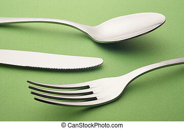 Fork knife spoon detail over a green background. Cutlery....
