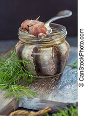 Fork on a jar of anchovies.