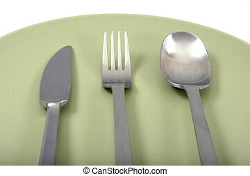 fork, spoon and knife on green plate