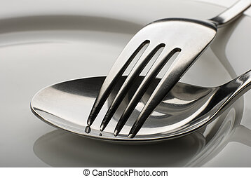 fork and spoon on a plate close up shoot