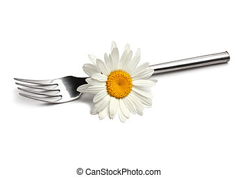 fork with chamomile flower