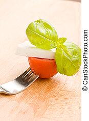 Fork with tomato and mozzarella