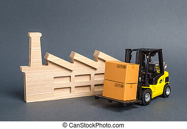 Forklift carries cardboard boxes and building a factory or plant. Services transportation of goods products, logistics in the industry, economic relations, infrastructure. Transportation company