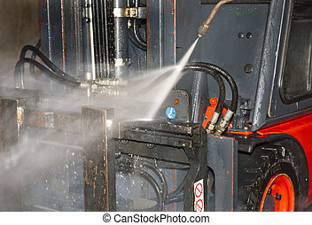 Forklift cleaning - High pressure water jet hosing down the...