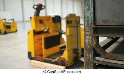 Yellow forklift in a modern storehouse