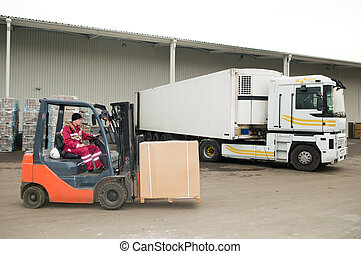forklift loader at warehouse outdoors