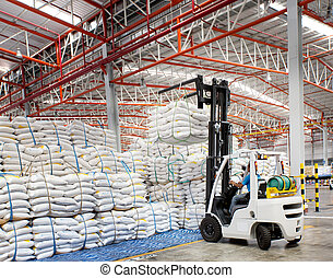 Forklift loader with big bag of sugar in distribution...