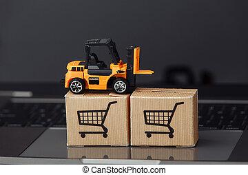 Forklift model on carton boxes on a laptop. Courier services and delivery concept