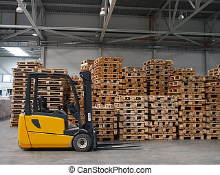 Forklift ready for work in a real warehouse